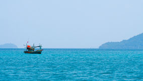 Fishing boat. S in vast sea at island Royalty Free Stock Images