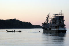 Fishing Boat burma, asian,. Small boat heading ashore from the main ship of a fishing fleet in Burma, asia Stock Photos