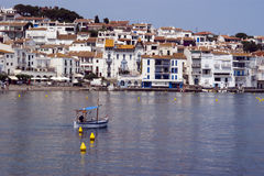 Fishing boat and Cadaques Catalunya Spain Stock Photos