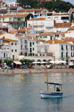 Fishing boat and Cadaques Catalunya Spain Stock Image