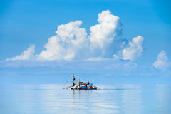 Fishing boat in calm sea Stock Images