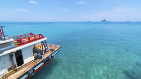 Fishing boat on the calm sea water. Royalty Free Stock Images