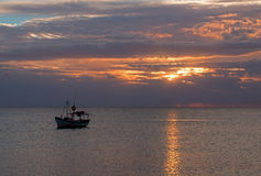 Fishing boat in Cancun's Puerto Juarez harbor at sunrise on Mexico's Caribbean coastline Royalty Free Stock Images