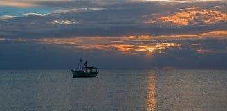 Fishing boat in Cancun's Puerto Juarez harbor at sunrise on Mexico's Caribbean coastline Stock Images