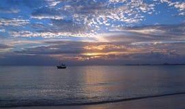 Fishing boat in Cancun's Puerto Juarez harbor at sunrise on Mexico's Caribbean coastline Royalty Free Stock Photo