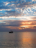 Fishing boat in Cancun's Puerto Juarez harbor at sunrise on Mexico's Caribbean coastline Royalty Free Stock Photos