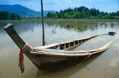 Fishing boat capsized on the river. Royalty Free Stock Images