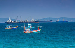 Fishing boat and cargo boat Stock Images