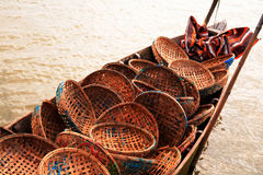 Fishing boat carrying baskets Stock Images