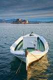 Fishing boat and a castle, Nafplio, Greece. Royalty Free Stock Image