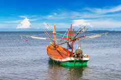 Fishing boat at clean beach Stock Photo