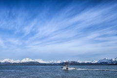 Fishing boat with cloud patterns