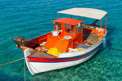 Fishing boat on the coast of Crete Stock Photos