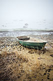 Fishing boat at coast foggy in the morning Royalty Free Stock Photography