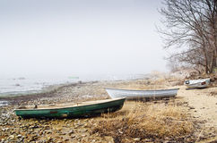 Fishing boat at coast foggy in the morning Royalty Free Stock Image