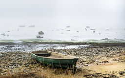 Fishing boat at coast foggy in the morning Stock Photo