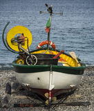 Fishing boat. Colourful fishing boat on beach in Noli, Italy Royalty Free Stock Image
