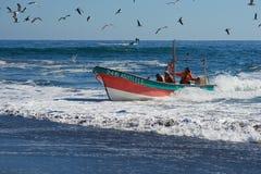 Fishing Boat Coming Ashore Stock Photography