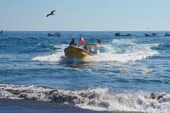 Fishing Boat Coming Ashore Royalty Free Stock Photos