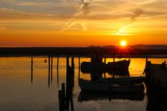 Fishing boat coming into the port Stock Photos
