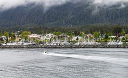 Fishing boat coming into Sitka, Alaska royalty free stock images