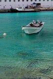 Fishing Boat by Cruise Ship Stock Photo