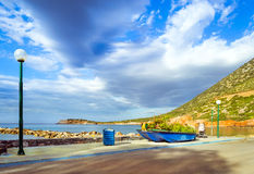Fishing boat decorated by flower bed Bali, Crete Stock Images