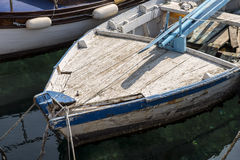 Fishing boat detail. Detail on the prow of an old, small, and very worn traditional croatian fishing boat Royalty Free Stock Photos