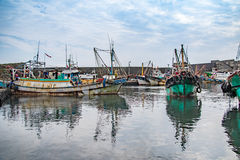 Fishing Boat Docked at Port. Several fishing boats docked at the port and their reflection stock image
