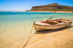 Fishing boat docked to coast on the beach of Crete, Greece Royalty Free Stock Image