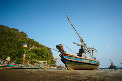 Fishing boat docking on the beach stock images