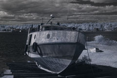 Fishing boat in dry dock. Infrared image of old fishing boat in dry dock Royalty Free Stock Photo