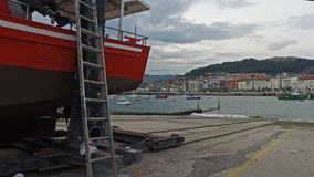 Fishing boat in dry dock Castro Urdiales 06 stock footage