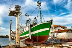Fishing boat in dry dock for repairs Royalty Free Stock Images