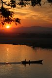 Fishing boat at dusk. Boats, on, the, ayeyarwady, river, Myanmar, asia Royalty Free Stock Photo