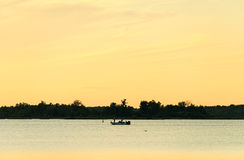 Fishing boat at dusk Royalty Free Stock Photos