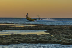 Fishing boat at dusk Royalty Free Stock Images
