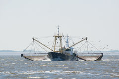 Fishing boat on Dutch wadden sea Stock Photography