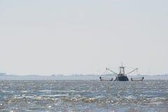 Fishing boat on Dutch wadden sea royalty free stock photo