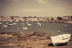 Fishing boat at ebb tide in Bretagne, France Stock Photo