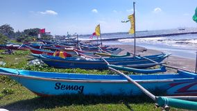 Fishing Boat at edge of beach Stock Image