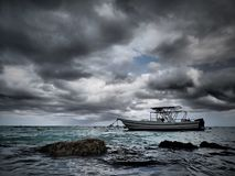 Fishing Boat On an Eerie Atlantic Ocean stock images