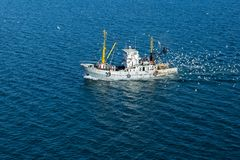 Fishing boat engaged in fishing, in Kerch strait. Royalty Free Stock Photos