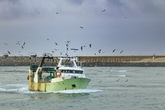 Fishing Boat Entering The Harbor Royalty Free Stock Photos