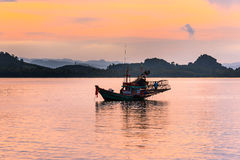 Fishing boat In the evening sea. In thailand Royalty Free Stock Image