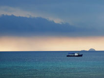 Fishing boat at evening sky Royalty Free Stock Photos