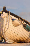 Fishing boat with fenders. Front of tatty white fishing boat with worn and split fenders Stock Photo
