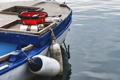 Fishing boat with fenders Stock Photo