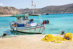 Fishing boat. Fisherman boat on the dock on one of the Greek islands Stock Photos