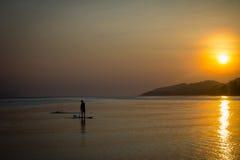 Fishing Boat with fisherman at Sunset on Koh Samui Stock Image